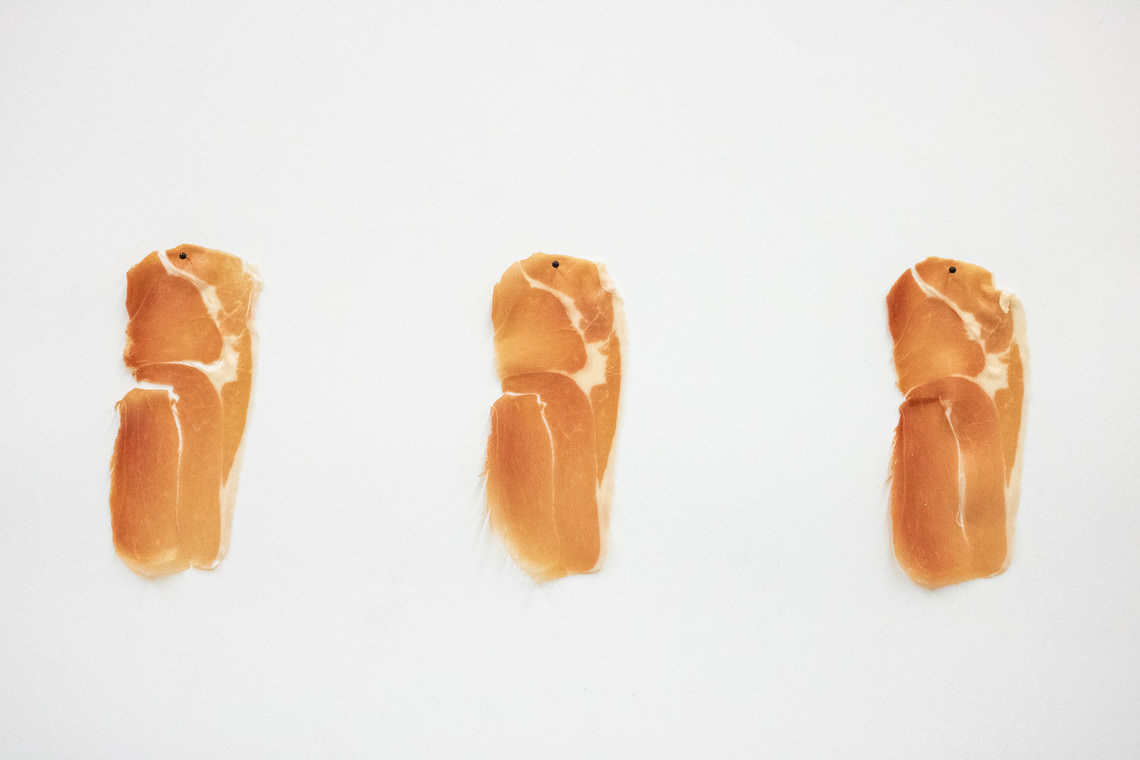 - untitled (prosciutto pinned to the wall slice after slice)